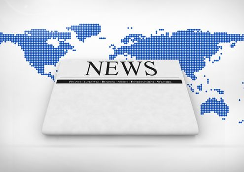 Newspaper over world map