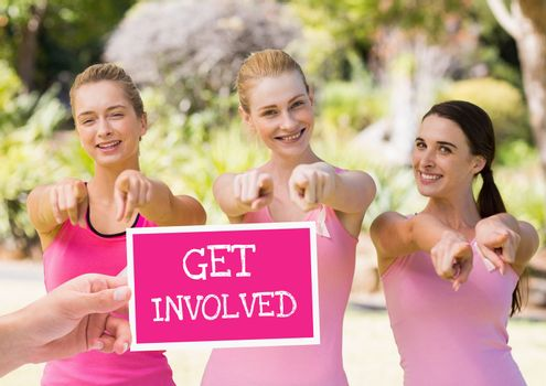 Get involved Text and Hand holding card with pink breast cancer awareness women