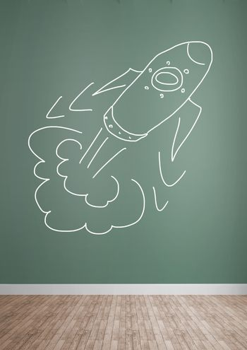 hand-drawn rocket on green wall
