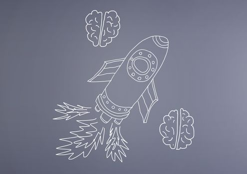 hand-drawn rocket and brain on wall