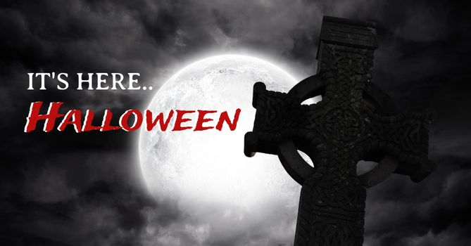 It's here Halloween text with gothic graveyard and moon