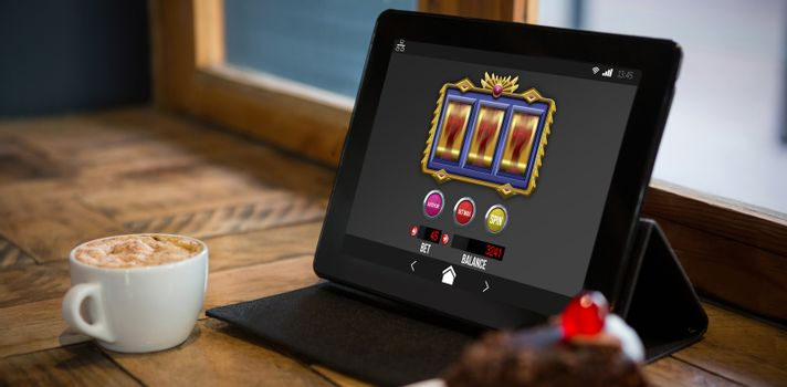 Composite image of slot machine on mobile screen