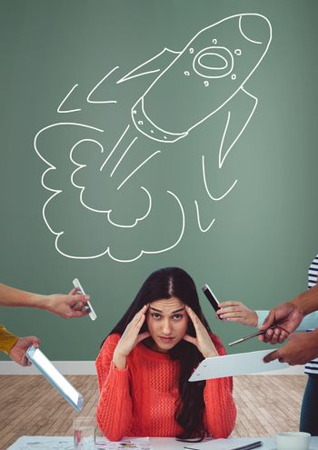 Creative but stressed woman with hand-drawn rocket