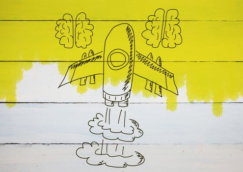 hand-drawn rocket and brains on wood