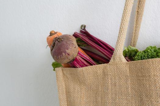 Fresh vegetables in grocery bag