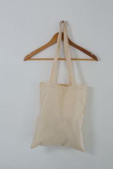 Beige bag on hanger
