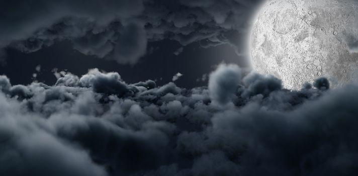 Moon shining between clouds