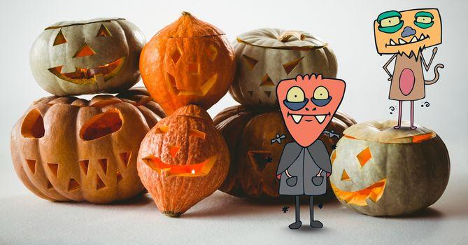 Cartoon Monsters standing with halloween pumpkins