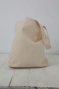 Beige bag on table