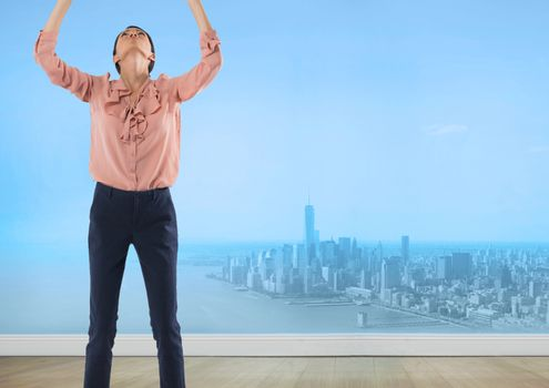 Businesswoman reaching to sky over city