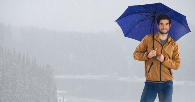 Man with umbrella over bright icy lake