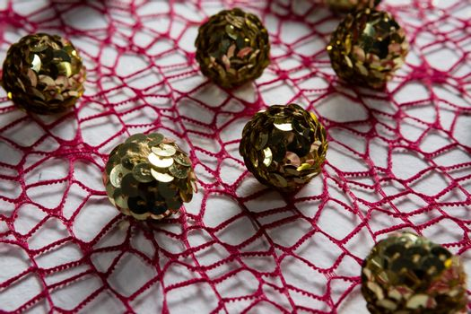 Sequin balls on pink fabric