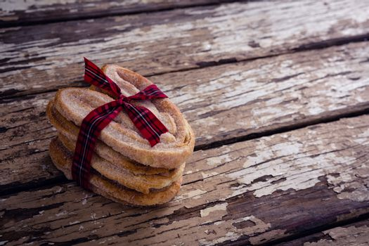 Stack of sweet food tied with ribbon