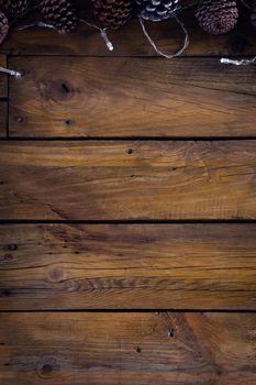 Christmas light on wooden plank