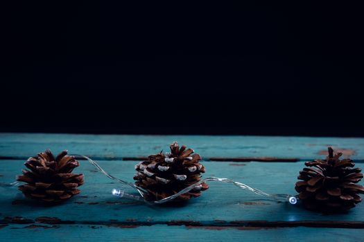 Pine cone decorated with christmas light