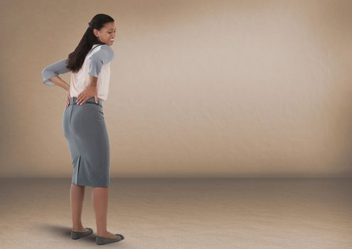 Businesswoman with sore back in room