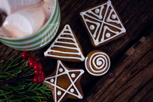 Cookies, mistletoe and hot chocolate on wooden plank
