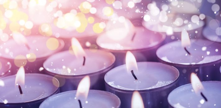 Illuminated candles during Christmas time