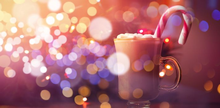 Coffee with marshmallow and candy cane