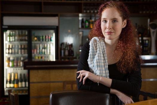 Beautiful waitress standing