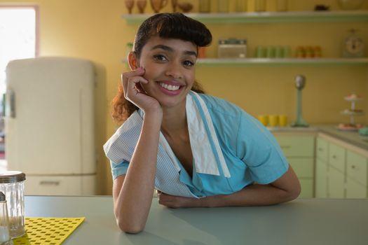 Waitress standing at counter