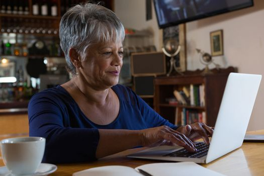 Waitress using laptop
