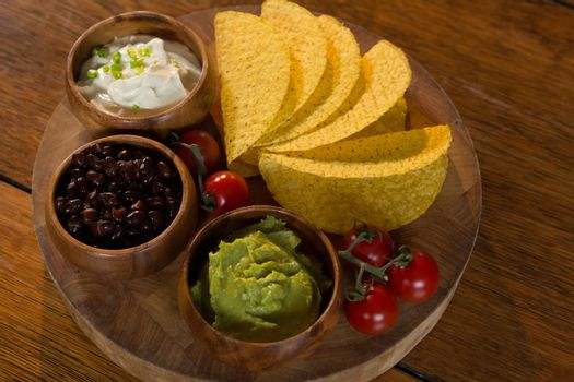Various mexican food on wooden table