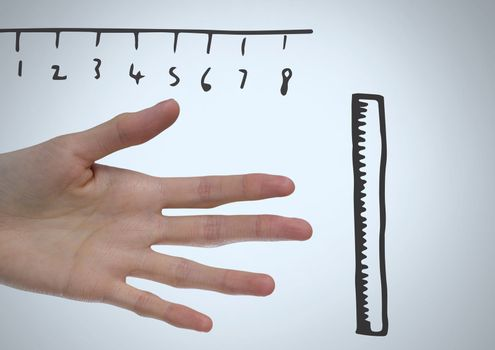 Rulers measuring size of long hand and fingers