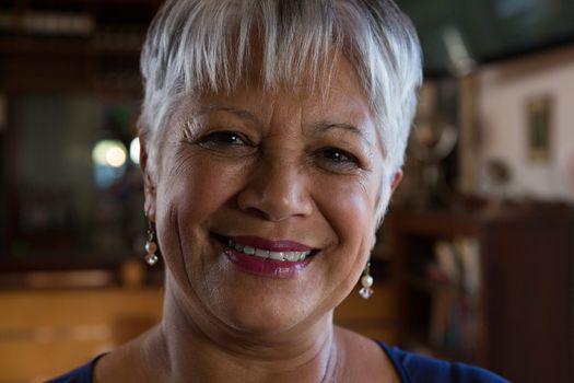 Portrait of waitress smiling