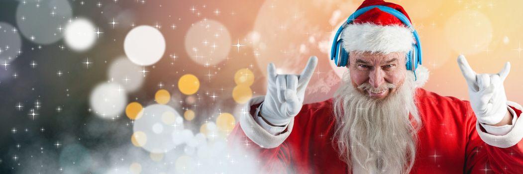 Santa with Winter landscape wearing DJ party headphones