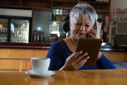 Waitress talking on his phone