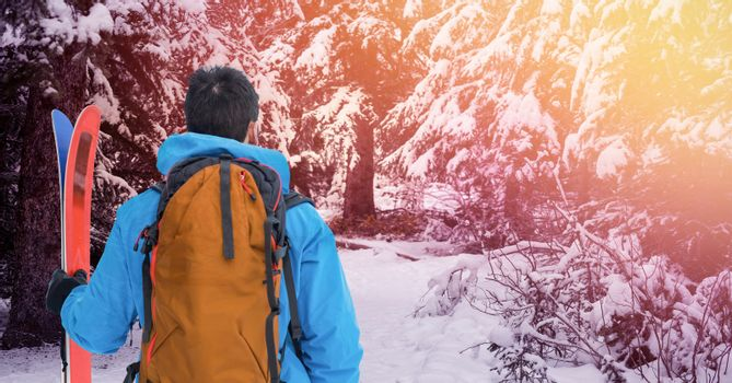 Man standing with skies in snow Forrest