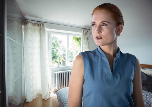 Sharp woman thinking by window