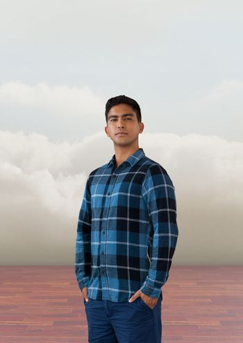 Businessman standing proud with clouds
