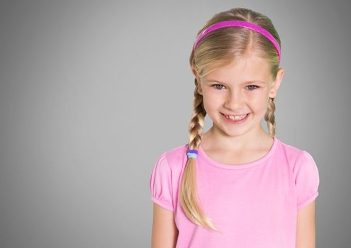 Girl against grey background with braided hair