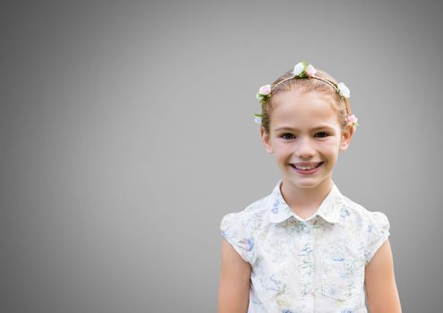 Girl against grey background with flowers in hair