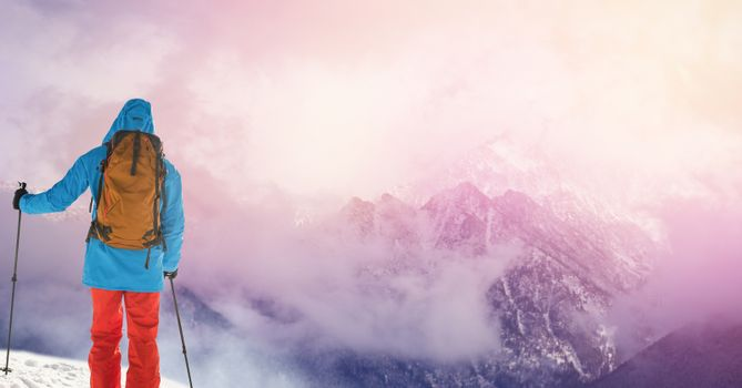 Man standing  with skies on slope