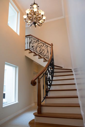 Staircase and chandelier at home