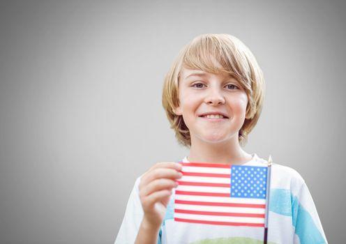 Boy against grey background with american flag