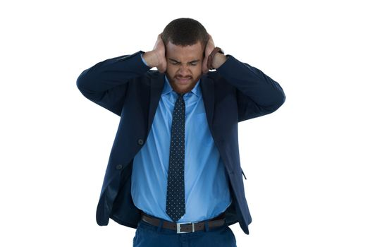 Irritated businessman covering his ears