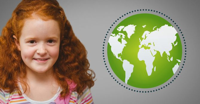 Girl against grey background with red hair and world globe