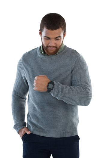 Male executive showing his smartwatch