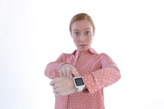 Businesswoman pointing at her smartwatch