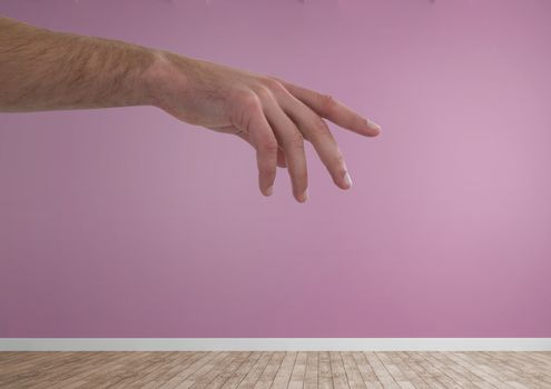 Hand reaching in pink room