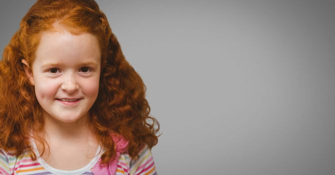 Girl against grey background with red hair