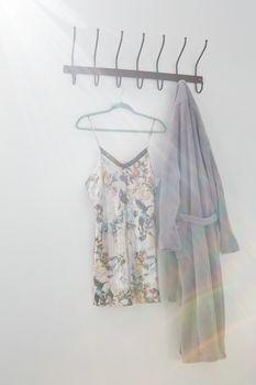 Bathrobe and nightwear hanging on hook