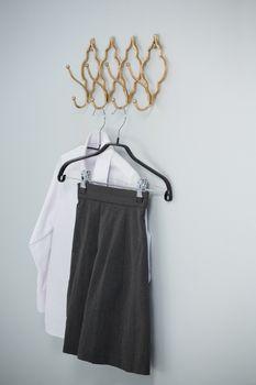 Formal shirt and skirt hanging on hook