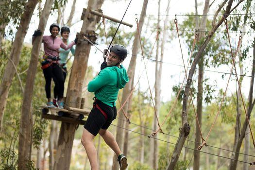 Man on zipline in adventure park