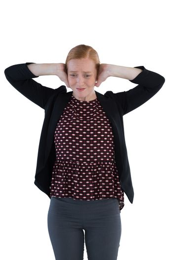 Annoyed woman covering her ears