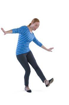 Woman balancing while stepping